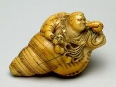 Netsuke ~ Carved ivory Male Figure Inside Conche Shell H: 1 x W: 2 1/8 x D: 1 5/16 inches (H: 3 x W: 5 x D: 3 cm)