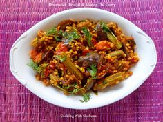 Side dish made with drumsticks, brinjals ( eggplant), and moong dal.