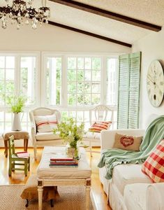 Cottage Living room inspiration- cream, green, and red. Neutral walls and couches with colored accents! And lots of small greenery and pillows!