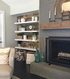 Thin modern floating shelves and a rustic planked wall for the win ? We knocked down the wall next to this fireplace to add dimension and more storage space in this room.Reclaimed barn wood from paint on the fireplace Gauntlet Modern Floating Shelves, Floating Shelves Kitchen, Glass Shelves, Floating Mantel, Shelves On Wall, Barn Wood Shelves, Recessed Shelves, Reclaimed Wood Floating Shelves, Unique Shelves