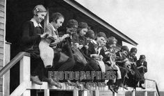 World War II girls knitting , May 1941 . Girls at the Finnermore wood camp huts , knitting sea stockings and jerseys for the crews of wartime convoys .
