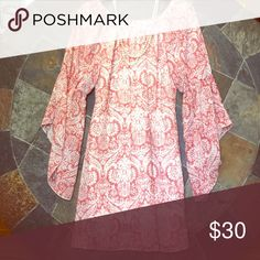 Asymmetrical sleeved dress Precious pink dress. Only worn once in Nashville. This dress goes perfect with some nude heels or even boots! Dresses