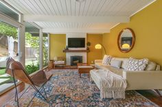Photo 6 of 17 in A Marin County Eichler With a Matching Backyard… Living Room Carpet, Rugs In Living Room, Living Spaces, House Color Schemes, Colour Schemes, Modern Homes For Sale, Backyard Studio, Carpet Sale, Sliding Glass Door