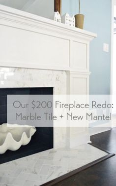 Our Inexpensive fireplace mantle redo with marble tile.   * Notice clam shell detail in insert!