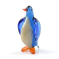 This blue penguin glass figurine was handblown and imported from Russia. It's bright colors and adorable aura is sure to please! Because each figurine is crafted by hand no two are exactly alike. Blown Glass Art, Glass Figurines, Penguins, Bright Colors, Russia, Miniatures, Bird, Crafts, Art