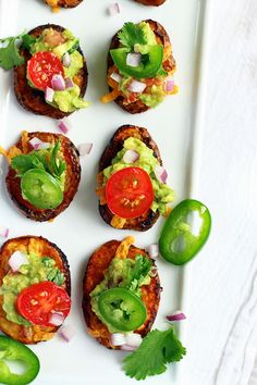 Spicy Nacho Potato Bites - ilovevegan.com - Crispy, spicy roasted potato medallions topped with melted vegan cheese, chunky homemade guacamole, and fresh vegetables. A perfect healthy spring and summer appetizer! #vegan #appetizer #Creamerpotatoes @LittlePotatoCo