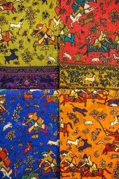 Drake's Wool and Silk Elephant Print Scarves on the left and Lightweight Wool Mughal Print Scarves on the right.