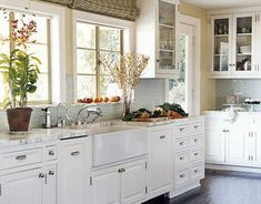 white kitchen with window cabinets