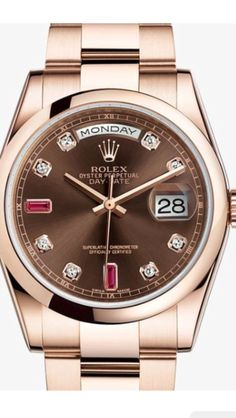 Rolex ( day/date ) with rubies and diamonds with rose gold casing ⌚️