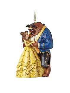 Disney Traditions Beauty & The Beast Hanging Christmas Tree Decoration - 10 cm Trust Disney to make Christmas even more magical. Hand-painted for a truly personalised finish, this enchanting Beauty and the Beast tree decoration comes packaged in a branded box, so it also makes a wonderful early gift for any fan of the classic film. Please note:not a toy or children's product - intended for adults only; due to this product's hand-painted finish, some unique variations should be exp...