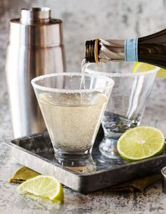 Pour shot of Gin, Elderflower and Prosecco Cocktail in short martini glass with sugared rim.