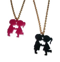 Laser cut black kissing kids necklace. This is a cool twist on the classic kissing kids image. It is made from black laser cut acrylic and is about 1.4 inches tall. It comes on an 18 inch gold plate necklace, please leave a note at checkout if you want a different colour/chain length. Back to main shop www.etsy.com/...