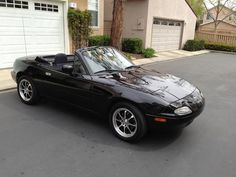 Miata Showcase - Detailed Description of 1997 Miata Touring Package - Rather clean 1997 with72,000 orginal miles.  Black cloth interior (which I prefer) with a 5 speed.  The car is stock except for some minor upgrades that will continue.  I created an Excel Workbook for this entire build.