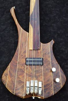 Great minimalism with awesome wood. orig: Custom handmade fretless bass guitar by ScottGuitarWorks on Etsy, $1500.00
