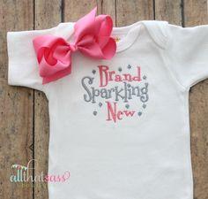 https://www.etsy.com/listing/181334426/baby-girls-bodysuit-and-bow-baby-shower?ref=listing-18  Baby Girls Bodysuit  and bow  Baby Shower by AllThatSassBoutique, $21.00