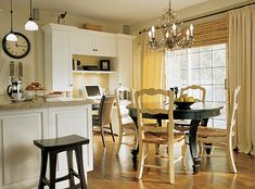 Need a new kitchen table and chairs.  Black table and white chairs...love the contrast. I love Candice Olson of Divine Designs.
