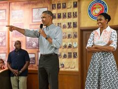 PHOTO: President Barack Obama, with first lady Michelle Obama, points toward a child in the audience as he greets troops and their families on Christmas Day, Dec. 25, 2014, at Marine Corps Base Hawaii in Kaneohe Bay, Hawaii.