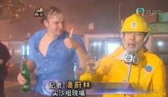 A hilarious dude photobombs a weather report in Hong Kong during Super Typhoon Vicente.