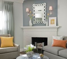 Silver metallic living room | 33 Modern Living Room Design Ideas | Real Simple  Silver Accents Cool metal touches give this room a sophisticated air. The scrolling mirror, the legs of the coffee table, even the fireplace andirons are all glossed in chic silver.   Interior design by Frances Herrera.