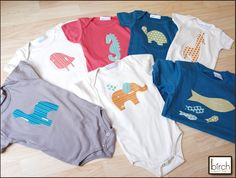 Great suggestion for making quick baby gift onesies.  Simply cut out a favorite animal shape using Pellon's Wonder Under and a fun fabric and apply according to Wonder Under's directions..  Super simple and fast!!