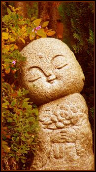 Jizo, protector of children who die before their parents, and of parents who lose a child. I remember seeing a temple in Japan with these sculptures.  I need to look for my photos.  I was obsessed with them - and I had no idea why.