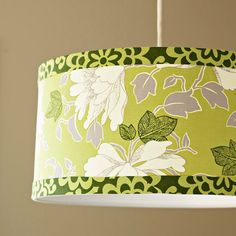 Cover a boring shade with pretty fabric! More lampshade #makeover ideas: http://www.bhg.com/decorating/do-it-yourself/accents/reinvent-a-lampshade/#page=2