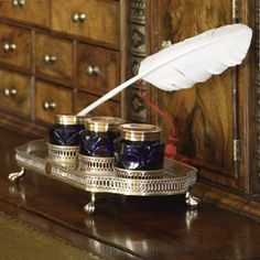 A Sheffield Plated inkstand, circa 1790 the shaped stand on four claw and ball feet, pierced galleries enclosing 3 cobalt cut-glass bottles Catherine The Great, Vintage Bottles, Pen And Paper, Writing Instruments, Wax Seals, Cut Glass, Glass Bottles, Antique Silver, Auction