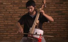 Landfill Harmonic: Paraguay recycled orchestra plays instruments made out of rubbish - Telegraph