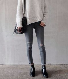 Distressed grey jeans and taupe-cream sweater. Cute.