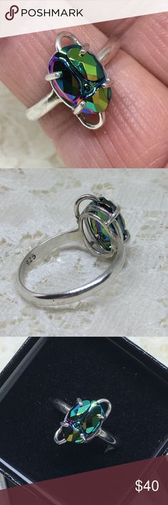 Handcrafted Ring w/ 12mm Swarovski Scarab This is a handcrafted ring made with a Green Swarovski Scarab Bead set in a Sterling Silver setting made in my studio by me. Ring is a size 9. Free resizing at time of order. designsbysteve Jewelry Rings