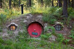 One of the many (purely decorative) round-door hobbit houses on the property.