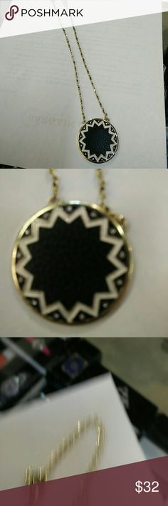 Vintage goldtone faux black leather center pendant This unique no brand pendant is attach with two chains at the top of the disc. See photos. Surrounding the black is white enamel in zigzag circle design.looks like 12 rhinestons surround the edge.  **note on looks missing ** 1955 Vintage Jewelry Necklaces
