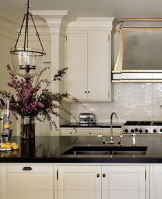Love the sparkling subway tile -- hood to die for. Wendy Posard interior designer, Nathan Kirkman photographer ~~