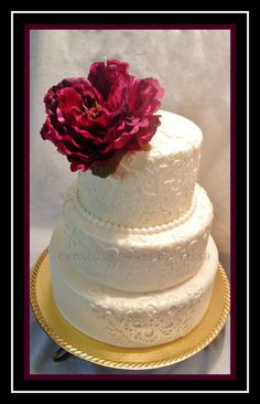 Lace detail fondant wedding cake with golden pearl airbrush finish and burgundy flower accents by Exclusive Cakes by Tessa