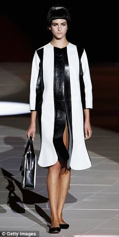 Power flats for spring: At both Marc Jacobs (left) and Giorgio Armani (right), flats were paired with tailored suits and eveningwear during the spring 2013 shows