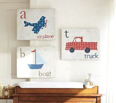 Love the boat wall art. From Pottery Barn Kids.