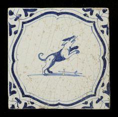 tiles of earthenware, depicting a dog within braces, with wing blade angle as motive, ca. 1620-1650 // tegels van aardewerk met tinglazuur, voorstellende verschillende dieren binnen accolades, met vleugelblad als hoekmotief, ca. 1620-1650