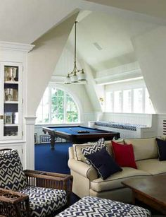 Don't like the patterned pillows or chairs, but love the alcove with the pool table.