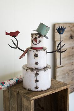Our Recycled Painted Iron Snowman is a jolly, happy fellow full of whimsical charm and vintage inspiration. He holds a red bird and sports a green top hat adding to the rustic nature of this adorable metal snowman. Country Christmas, Homemade Christmas, Rustic Christmas, Christmas Holidays, Christmas Decorations, Christmas Ornaments, Homemade Xmas Decorations, White Christmas, Happy Holidays