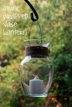 take a flower vase and wrap twine around the neck of the vase...add a wire hanger and you have an attractive lantern for outside use