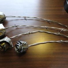 Roses Crafted From Welding Steel And Barbed Wire.