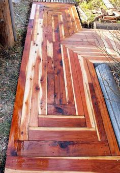 Sidewalk made from recycled redwood lumber.  It does not shrink and expand like cement would which causes cracks.  Wood also warms up more quickly in the winter helping to melt off snow and ice.
