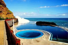Sea-water pools in Porto da Cruz, Madeira Island - Portugal Pool Water Slide, Water Slides, Places In Portugal, Portugal Travel, Funchal, Paragliding, Beach Pool, Beautiful Places To Visit, Island Life