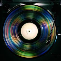 nklaw: Took a picture of a vinyl record spinning with flash on. The outcome was amazing.