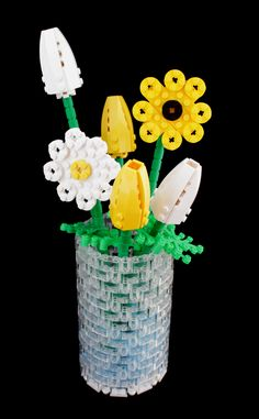 DIY LEGO flowers - How to build LEGO bouquet http://www.legolanddiscoverycenter.com/chicago/news-events/news/1497/how-to-build-lego-flowers-in-a-vase.aspx