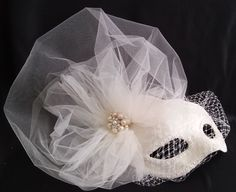 Ivory handmade bridal mask with birdcage veil and tulle fascinator pearls