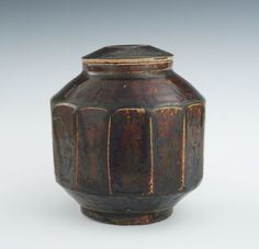 """A Korean Lidded Rice Container, 19th Century Faceted body raised on tall foot with reduced opening, with lid, in brown glaze with yellow undertones. Measures 5-3/4""""T.:"""
