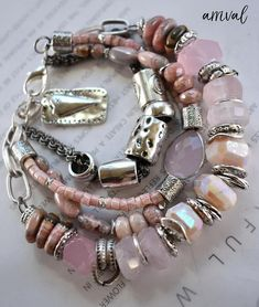 ❘❘❙❙❚❚ ON SALE ❚❚❙❙❘❘ - A new stunning bracelet with vivid pink stones~ just picked up from Tucson!! ~ with four strands one of rolo link chain with large floating beads moving along, two attached to this oval of sterling silver set bezel set multi faced pink quartz, to two strand one