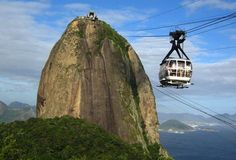 """Sugarloaf Kiosk @ Rio de Janeiro, Brazil Once upon a time, someone looked up at that behemoth of a rock and said, """"One day I'm going to build a kiosk on that rock. And there will be cable cars, and beer, and online content extolling its virtues!"""" And he was right. Perched 1,296ft over Rio, the kiosk is only accessible by a 75-person cable car... or by climbing the rock. [Thrillist]"""