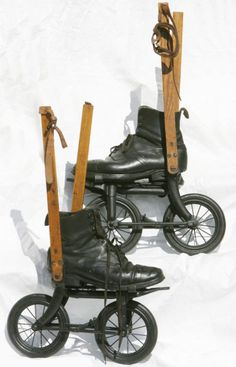"""A pair of the first roller skates which were invented in London in 1897. Known as """"Road Rollers"""", they were incredibly popular, especially with businessmen who used them to skate to and from work. On a smooth surface skaters could reach speeds of 16 miles per hour though each of the contraptions weighed around 40 lbs."""
